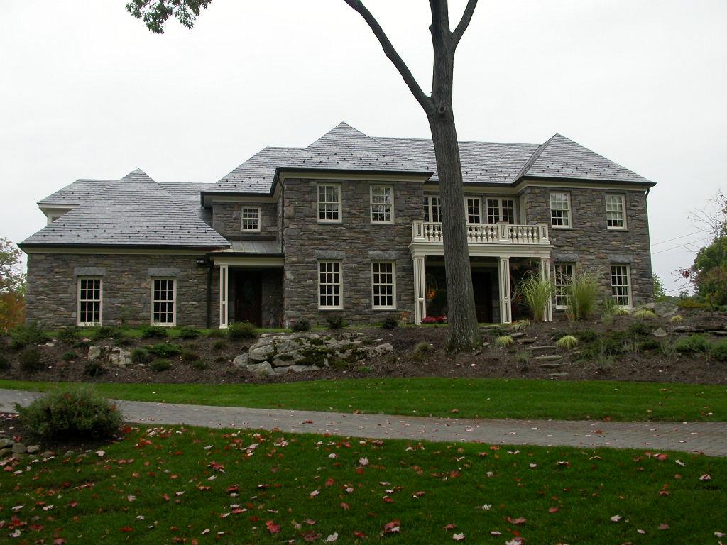 Stone manor home granite house tuxedo gray granite for Tuxedo house