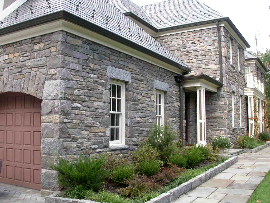 Stone manor home granite house tuxedo gray granite for Bluestone homes