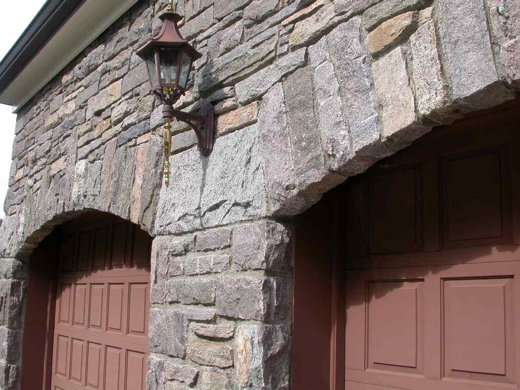 Stone arch at garage
